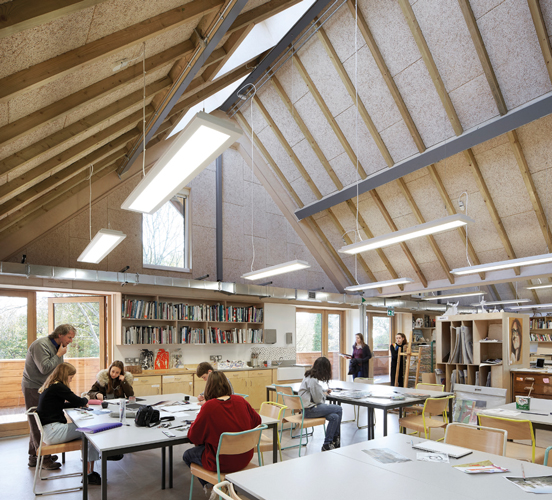 <p>The open-plan arts studio on the first floor can be sub-divided by purpose made timber units. © Hufton+Crow</p>