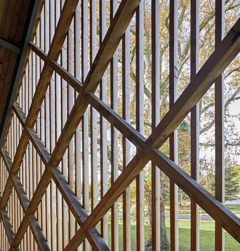<p>The oak diagrid is clad with larch slats to create a lattice screen. <span>© Hufton+Crow</span></p>