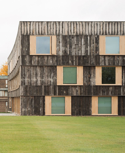 <p><span>The external cladding is made of timber reclaimed from French railway carriage floors. © David Grandorge</span></p>