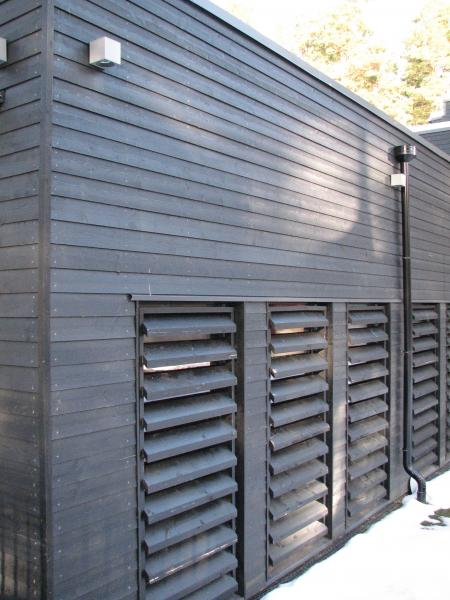 We supply factory finished timber products including black painted featheredge cladding