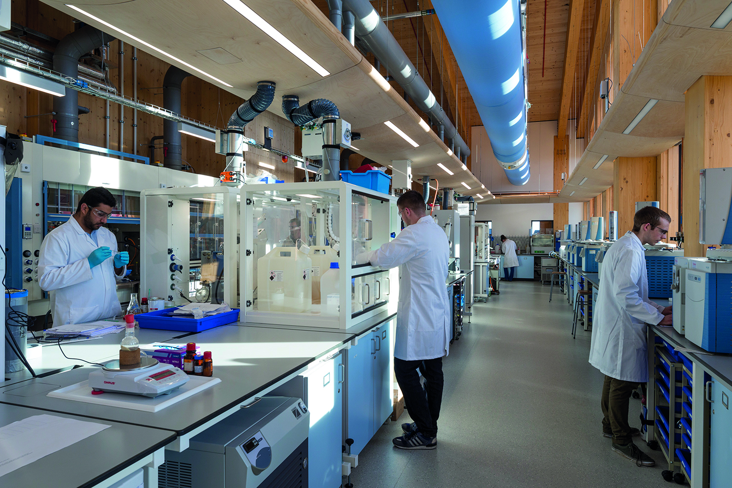 <p>The timber structure and services in the laboratories are exposed. © Martine Hamilton Knight</p>