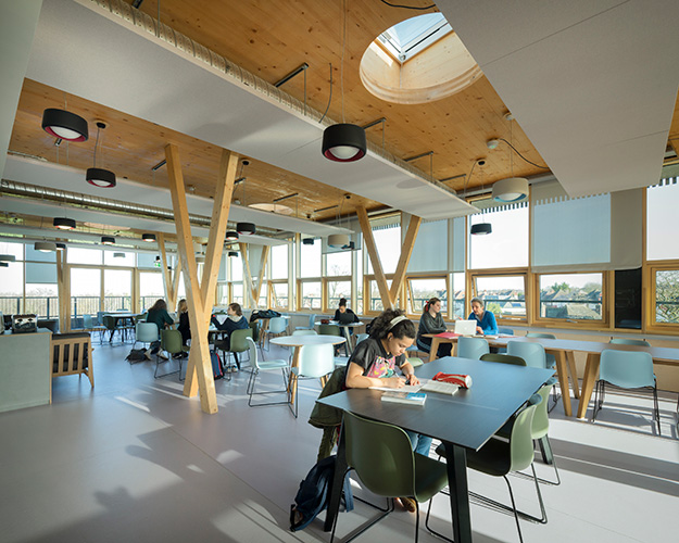 <p><span>The glulam/CLT structure and timber curtain walls create a warm yet light-filled sixth form common room. © Anthony Coleman</span></p>