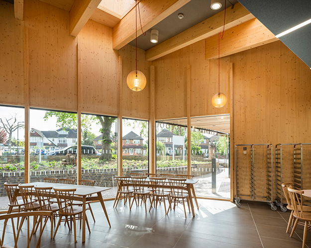 <p>Glulam beams radiate from the main dining hall space. © Anthony Coleman</p>