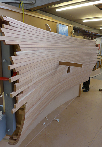 <p>A prototype of the double-curved cherry slats is tested in James Johnson's workshop. <span>© Ian Ritchie Architects</span></p>