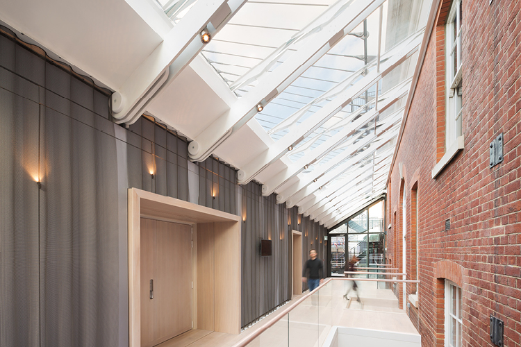<p>A new glazed foyer gives access to the recital hall. <span>© Ian Ritchie Architects</span></p>