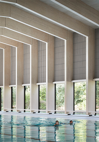 <p>Large glazed panels run between the glulam columns. © Hawkins\Brown</p>