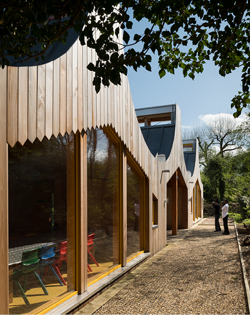 <p>Gables are clad with western red cedar boards, laid vertically. © Jim Stephenson</p>