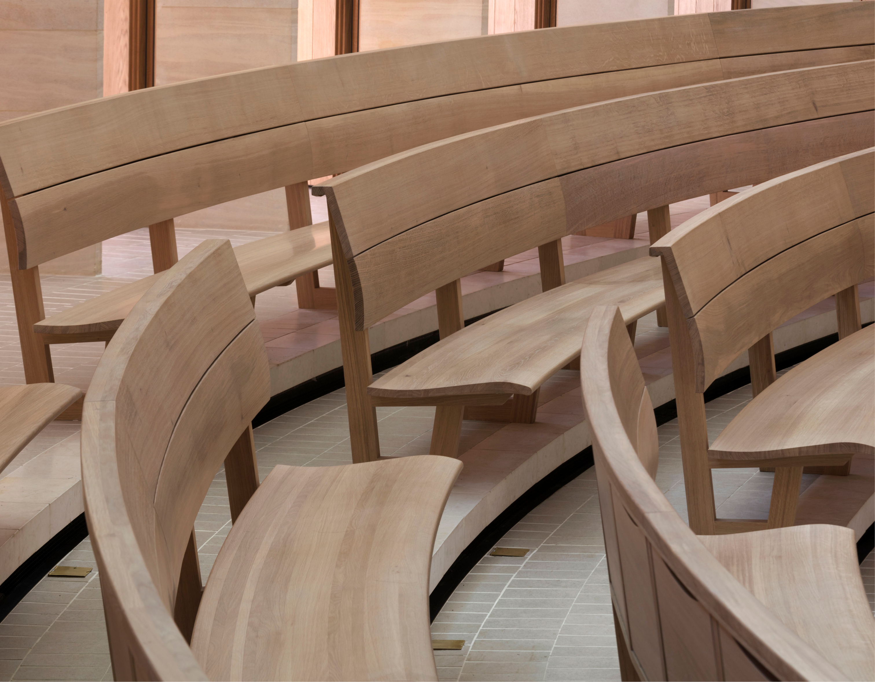 <p><span>The curved oak benches are carefully profiled to give a comfortable sitting position. © Nick Kane</span></p>