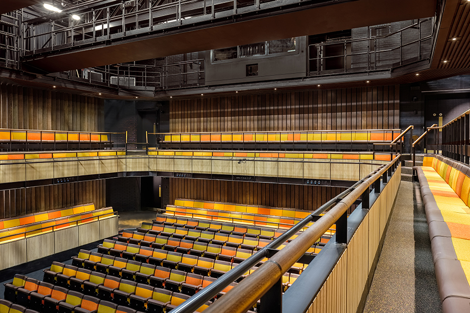 <p>The auditorium walls are lined with vertical oak boards to assist attenuation<br /><span>© Fred-Howarth</span></p>