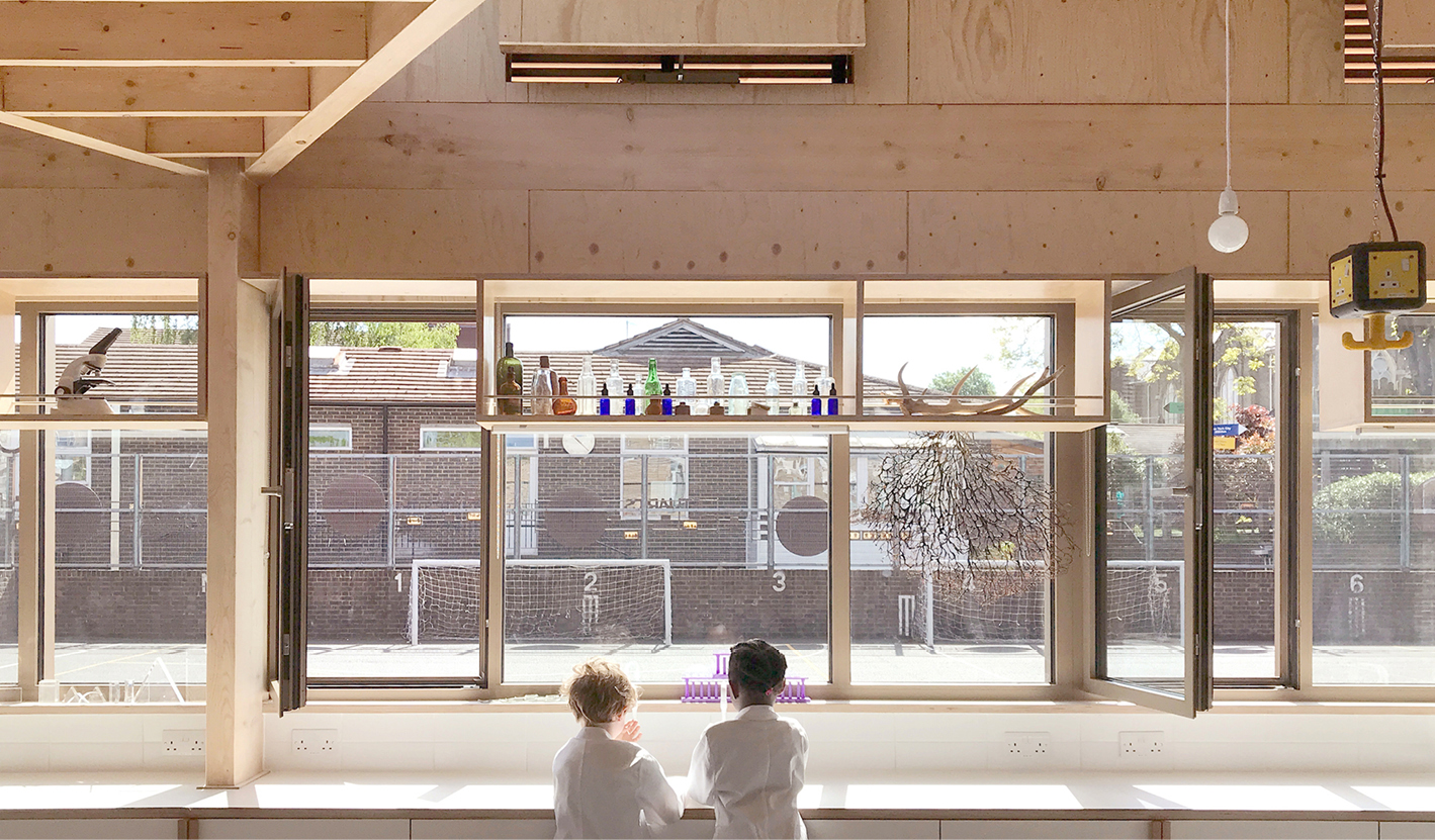 <p>The glazed east wall looks out onto the playground and is fitted with work surfaces and sinks. Photography: © Nick Kane</p>