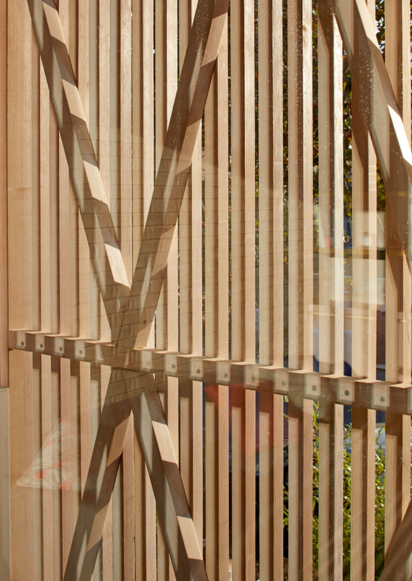 <p>The slats which screen the glazing are braced with diagonal and horizontal battens. Photography: © Edmund Sumner</p>