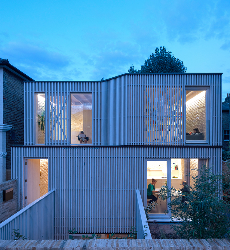 <p>Vertical cedar slats are used as cladding, screens to the glazing and as external balustrades. Photography: © Edmund Sumner</p>