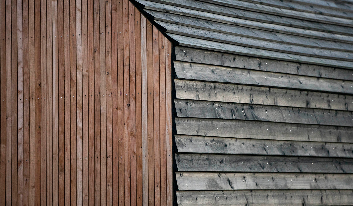 <p>Side walls and roof are clad with black-stained weatherboards and gables are clad with larch. Photography © Will Scott</p>