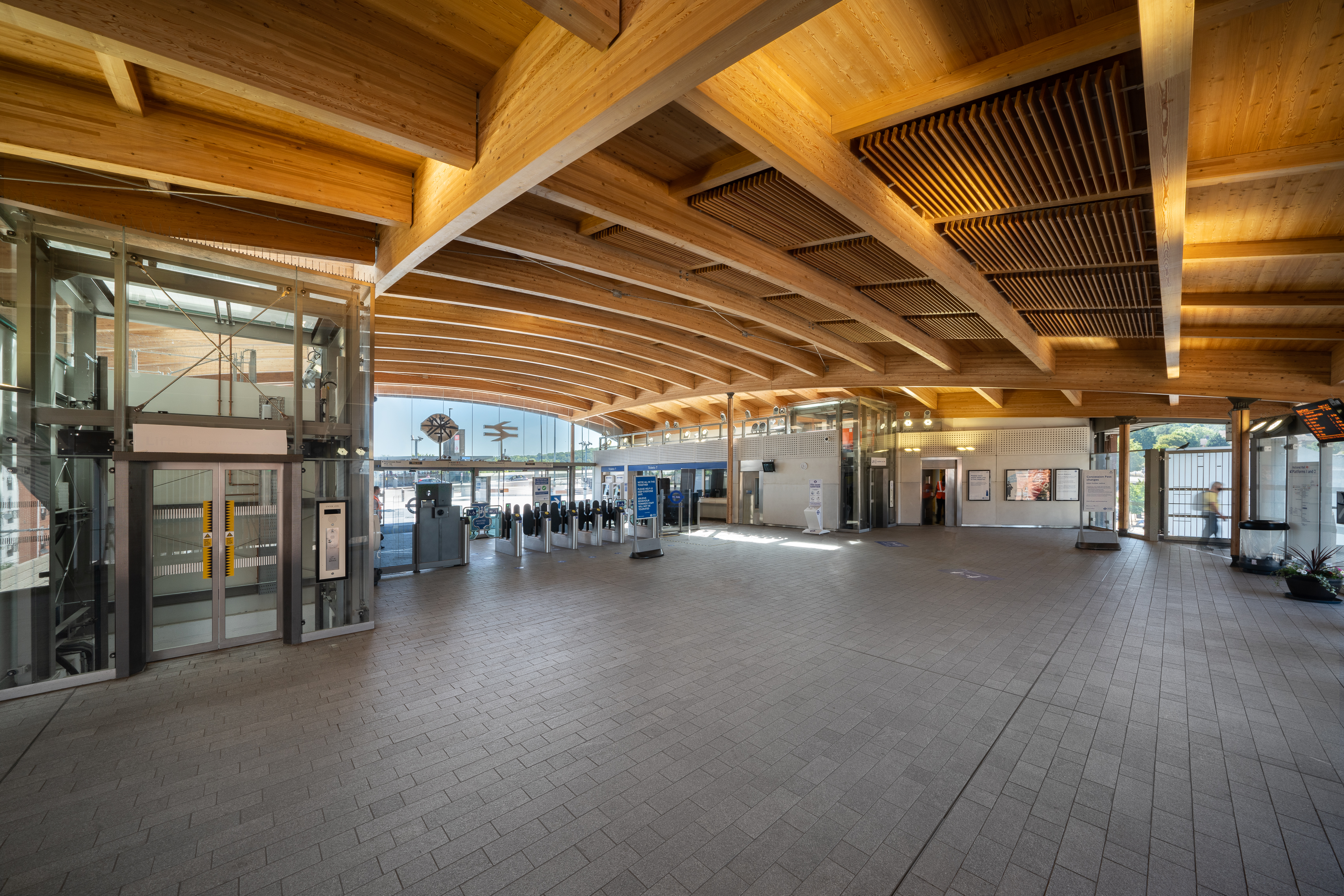 <p>The timber roof imparts a warm, natural quality to the interior of the station. Photography © Richard Lewisohn</p>