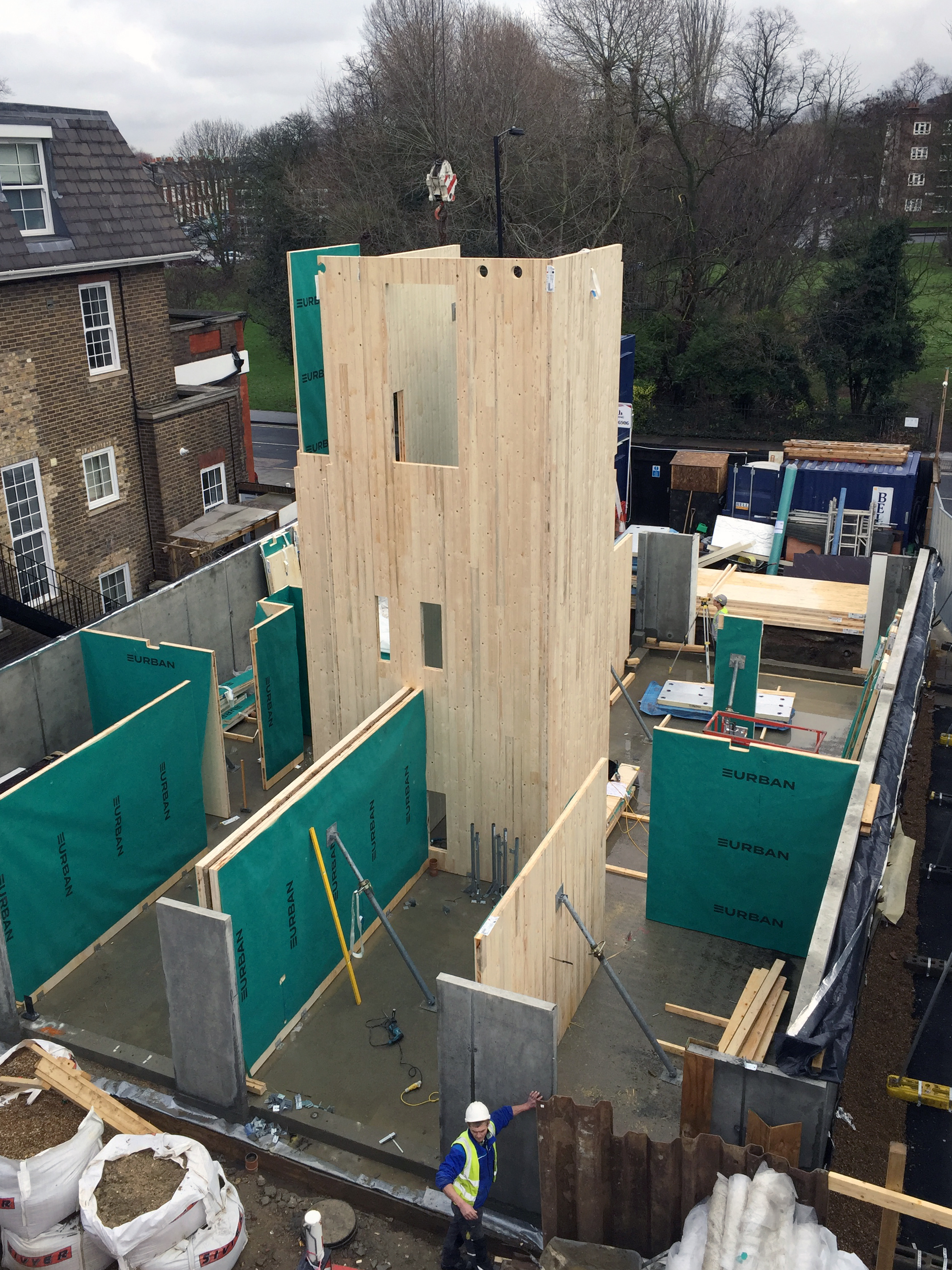 <p>The CLT staircase core and the twin CLT party wall have been lifted into place. © Tikari Works</p>