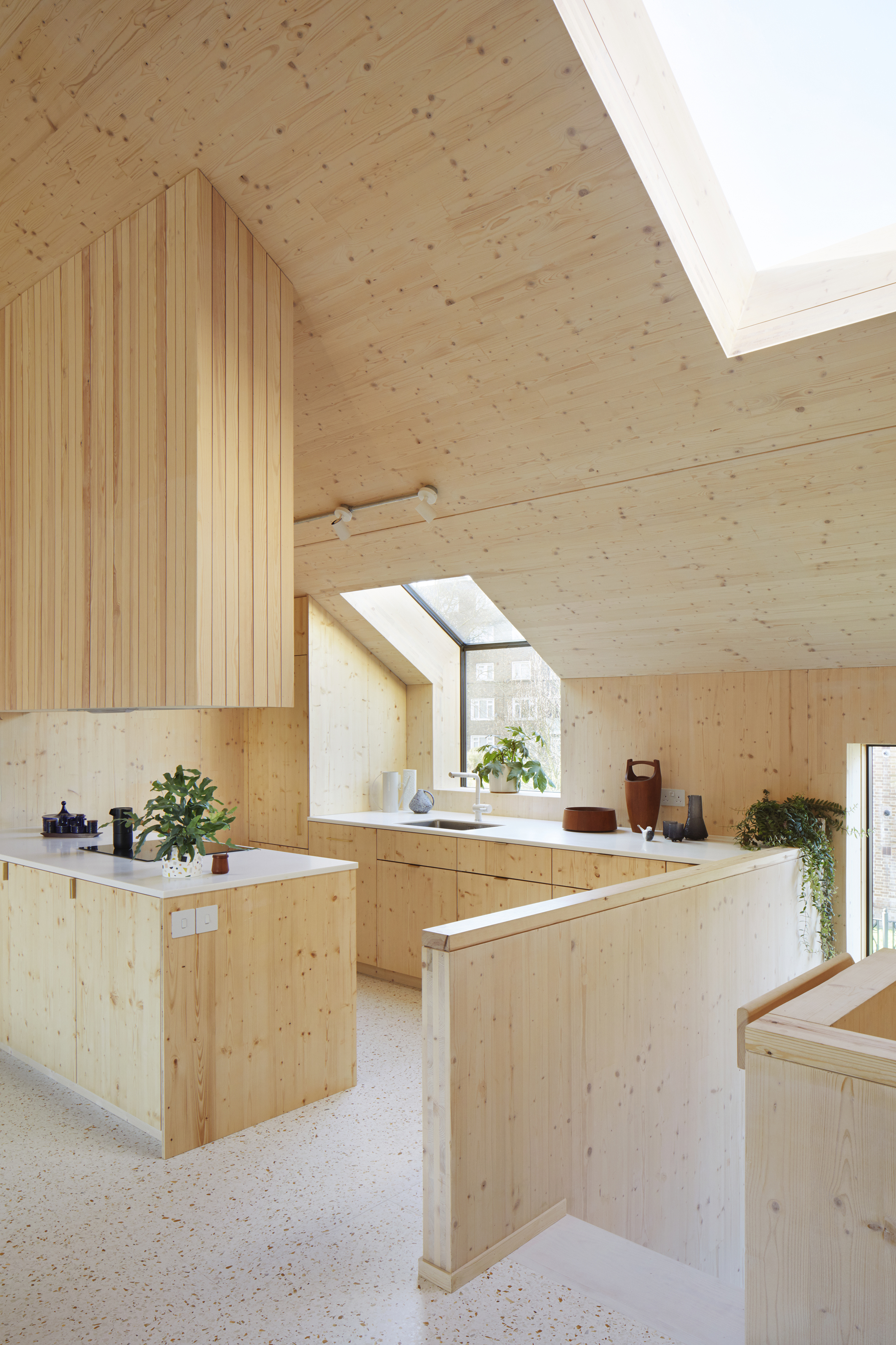 <p>The kitchen cupboards and joinery are made of spruce to match the CLT walls. © Jack Hobhouse</p>