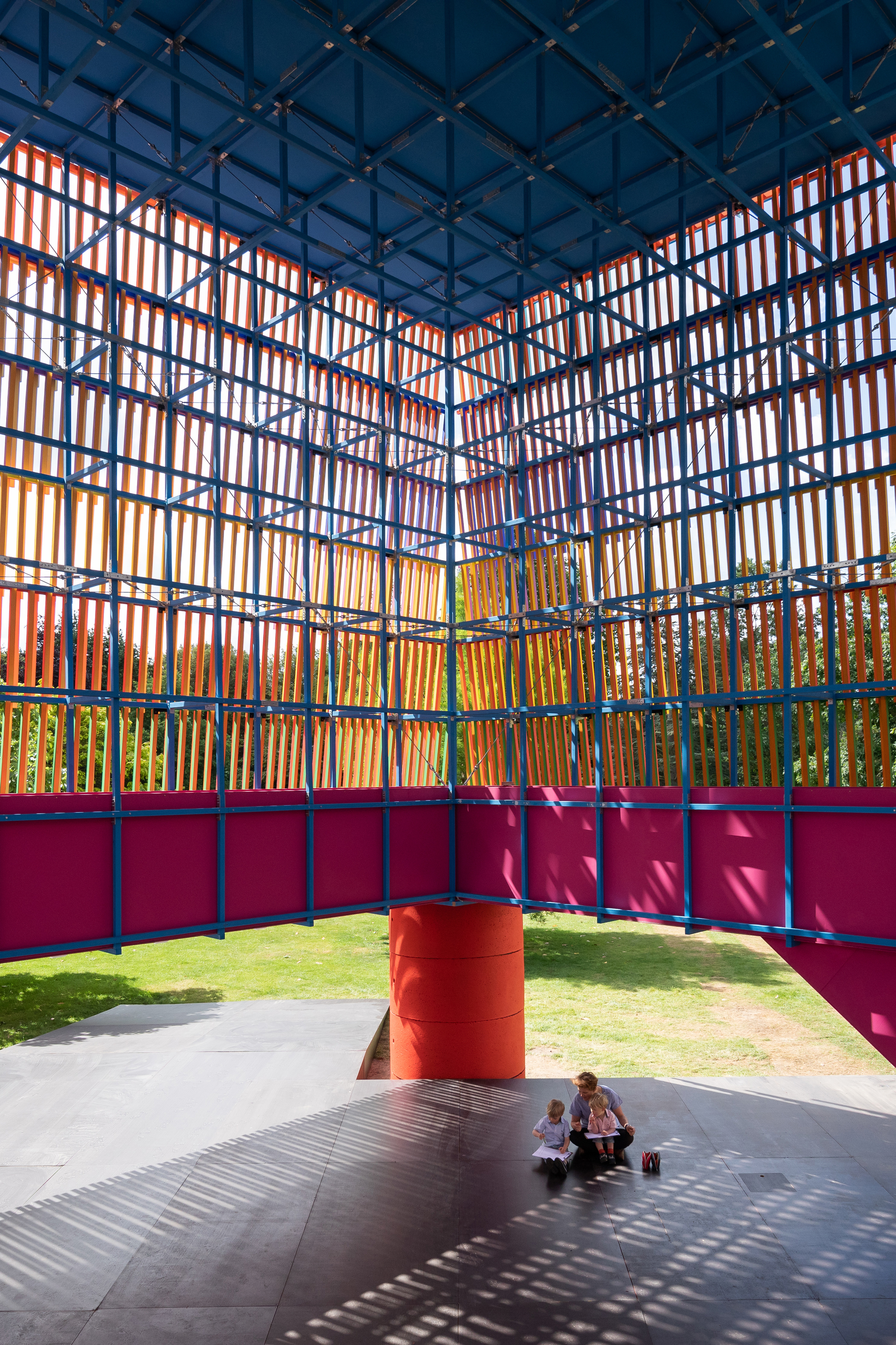 <p>A steel walkway with a shocking pink ply balustrade supported the lattice structure. Photography © Adam Scott</p>