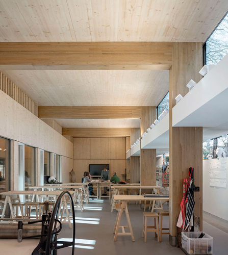 <p>The Arts Studio has a warm, lofty interior, with oak glulam portals supporting CLT wall and roof panels.</p> <p><span>© Peter Cook</span></p>