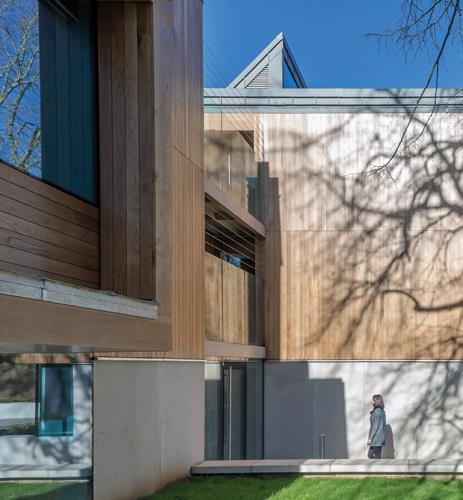 <p>The Garden Pavilion is clad externally with a rainscreen of vertical oak boards.</p> <p><span>© Peter Cook</span></p>