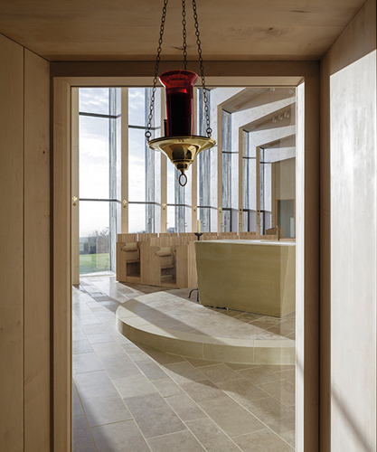 <p>Sunlight is reflected off the glulam columns on the south wall.</p> <p><span>© Peter Cook, Tim Crocker</span></p>