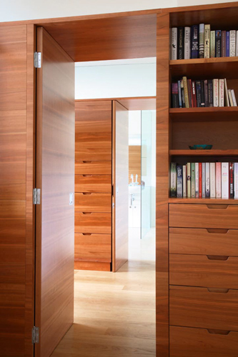 <p>Clothes storage in the dressing room is provided by cherry slip matched veneered cupboards and drawers.</p> <p><span>© Fisher Hart/VIEW</span></p>