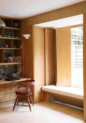<p>The dayroom is fitted with shelves with a built-in bureau and a pair of bay windows and window seats, all built of European oak.</p> <p><span>© Fisher Hart/VIEW</span></p>