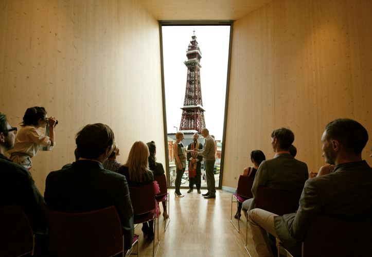 <p><span>The ceremony hall on the second floor has a dramatic view of Blackpool Tower.</span></p> <p>© Alex de Rijke</p>