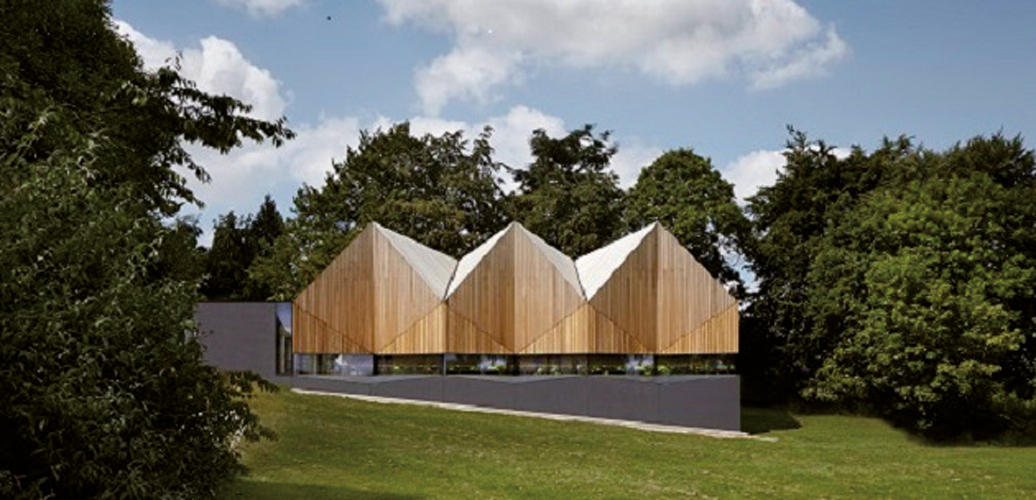 <p>The pitched and tapered roofs and gables form a complex 'origami' hat.</p> <p>© Jack Hobhouse</p>