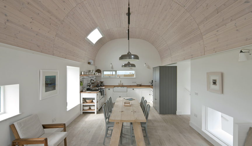 <p><span>The ceilings and floors are lined with timber, creating warm and gently textured surfaces which reflect traditional interior techniques.</span></p> <p><span>© David Barbour</span></p>