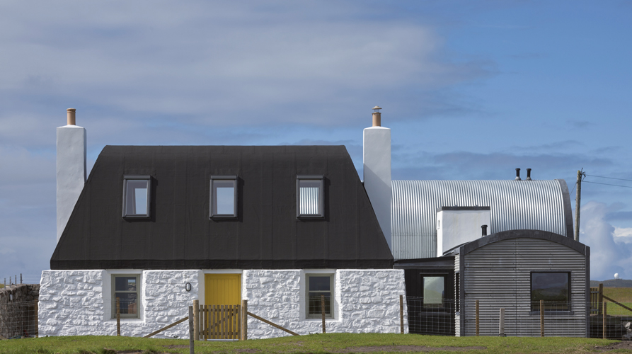 <p>The rebuilt 'black house' and new buildings alongside reflect the character of traditional croft building in Tiree.</p> <p>© David Barbour</p>