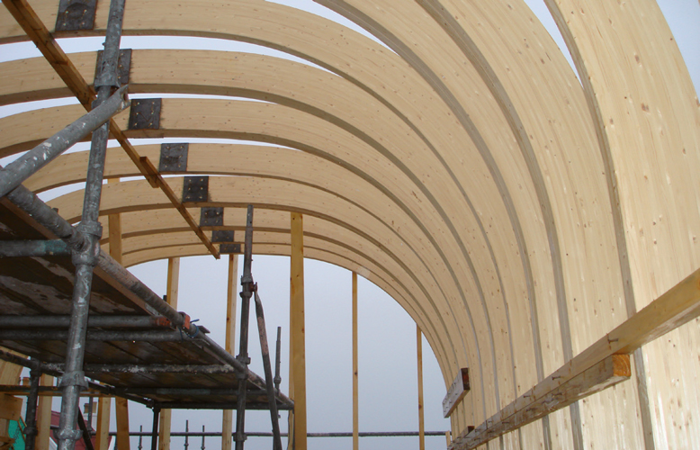 <p>The glulam beams were transported in sections to Tiree and connected on site at their apexes.</p> <p>© David Barbour</p>