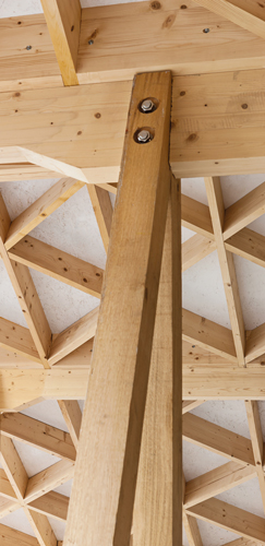 <p><span>The green oak A-frames were bolted into notches in the glulam beams.</span></p> <p><span>© Robert Holmes</span></p>