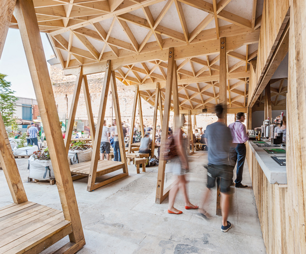 <p>The timber roof canopy and its A-frame support structures are exposed.</p> <p><span>© Robert Holmes</span></p>
