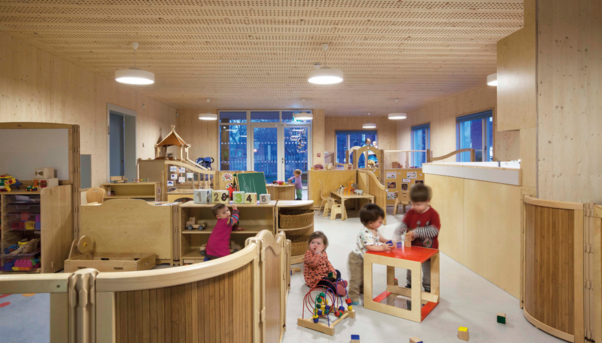 <p><span>The babies' playroom has direct links to the other playrooms.</span></p> <p><span>© Malcolm Fraser Architects / Angus Bremner</span></p>