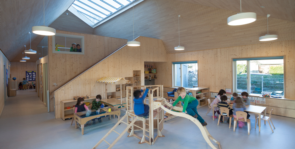 <p><span>The three-to-five year old children's playroom is a free-flowing space with a mezzanine over the WCs.</span></p> <p><span>© Malcolm Fraser Architects / Angus Bremner</span></p>