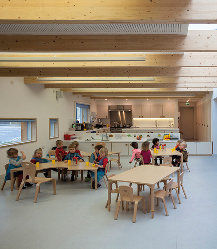 <p><span>The welcome/circulation space has a children-sized kitchen which divides it from the main kitchen.</span></p> <p><span>© Malcolm Fraser Architects / Angus Bremner</span></p>