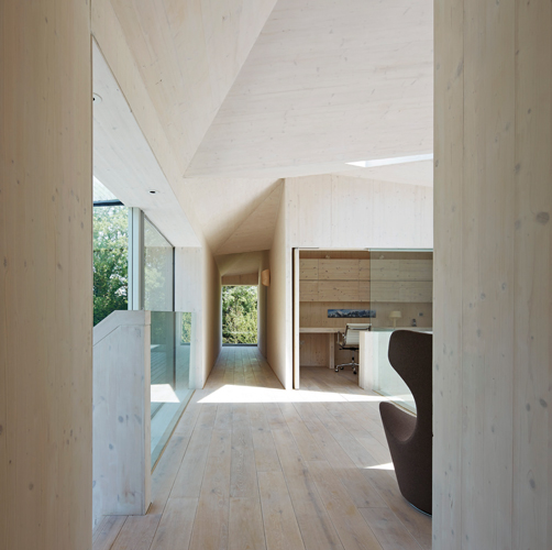 <p><span>CLT wall and roof panels give a warm and tactile quality to the first floor.</span></p> <p><span>© Wilkinson King Architects</span></p>