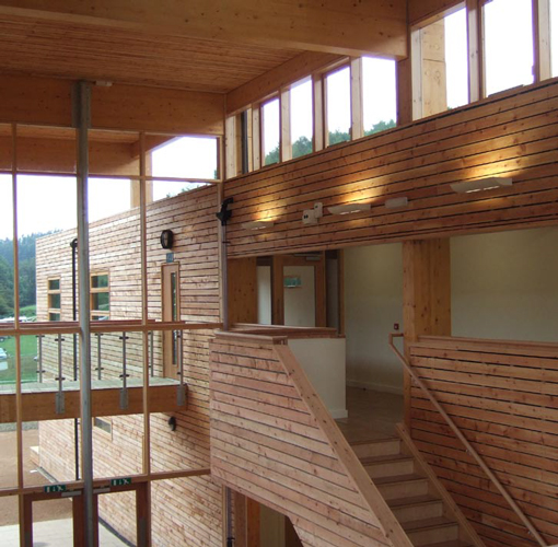 <p><span>The interior of the foyer is lined with larch boards.</span></p> <p><span>© White Design</span></p>