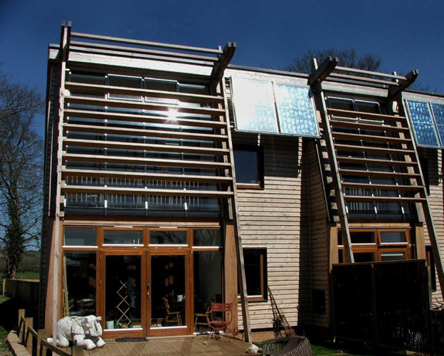 <p><span>The sun spaces on the south facade of the North Wing are screened at upper levels by Douglas fir louvres.</span></p> <p><span>© Nigel Griffiths</span></p>