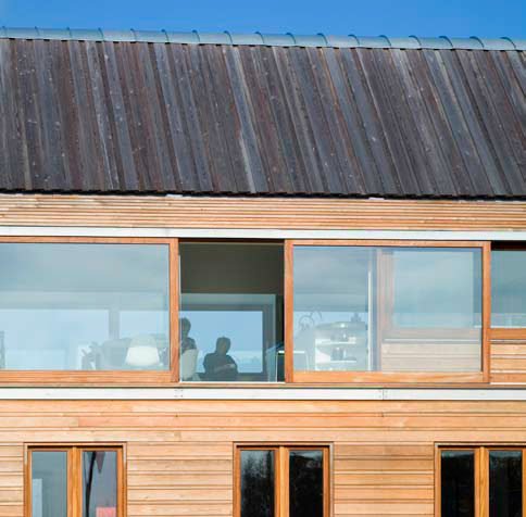 <p><span>Siberian larch board-on-board timber roof with standing seam zinc ridge.</span></p> <p><span>© Dennis Gilbert / VIEW</span></p>