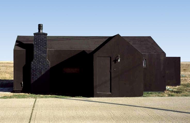 <p>The original building was painted with tar. The new one is finished with a synthetic rubber membrane to match the vernecular style.</p> <p>© The Wood Awards</p>
