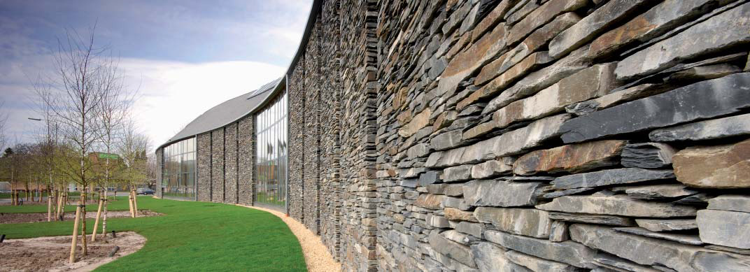 <p><span>The curved walls are clad with slate.</span></p> <p><span>© Renzo Mazzolini</span></p>