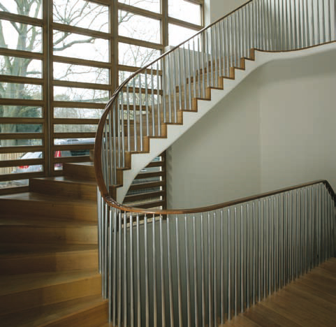 <p><span>The main staircase has treads of solid European oak and a black walnut handrail supported on shaped aluminium balusters.</span></p> <p><span>© Richard Haughton</span></p>