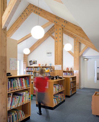 <p>The glulam portal frame structure is clearly visible in the library.</p> <p>© Beccy Lane</p>