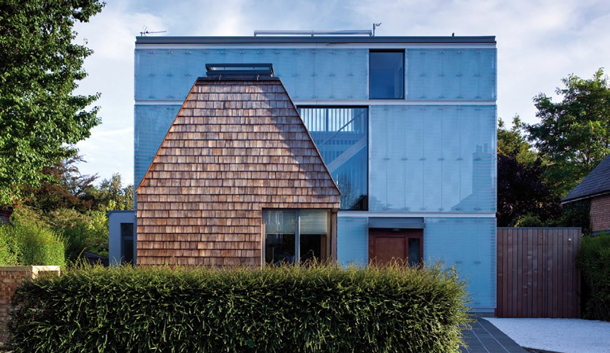 <p><span>The front of the house is clad with a mix of semi-reflective fritted glass and cedar shingle.</span></p> <p><span>© David Butler</span></p>