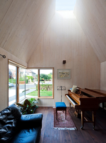 <p><span>The cross-laminated timber structure of the small single-storey extension is exposed to take advantage of its warm, natural finish.</span></p> <p><span>© David Butler</span></p>