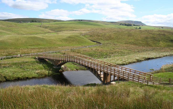 <p><span>The completed bridge, with a glimpse of Penyghent on the horizon.</span></p> <p><span>© Peter Lambert, YDNPA</span></p>