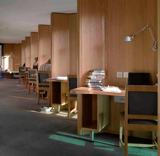 <p><span>The building interior is finished with bespoke oak veneer panelling and solid oak reader desks and shelves.</span></p> <p><span>© Nick Kane</span></p>
