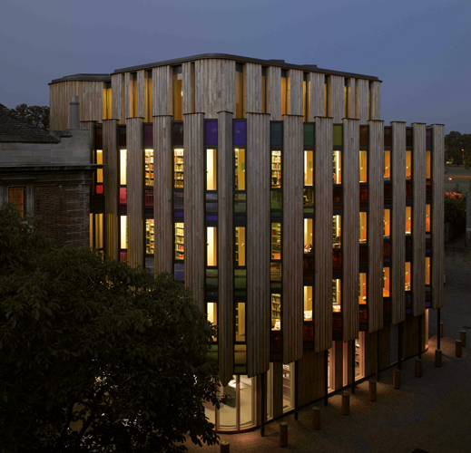 <p><span>Three stories of reader carrels project beyond the perimeter of the original building.</span></p> <p><span>© Nick Kane</span></p>