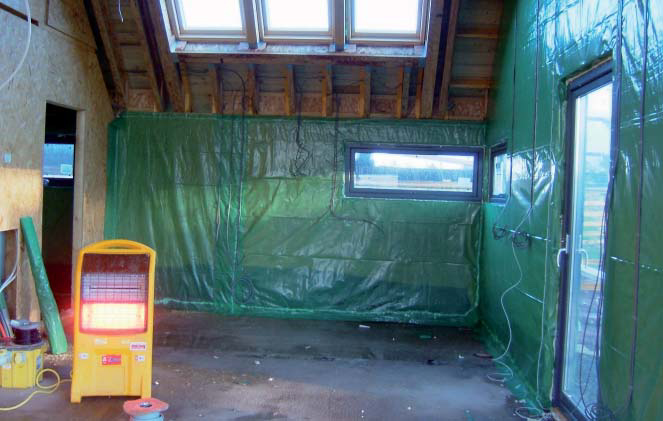 <p>Polythene acts as a primary air tight barrier, fitted to the OSB board. A service void is provided on top of this.</p> <p>© Steve Mackan</p>